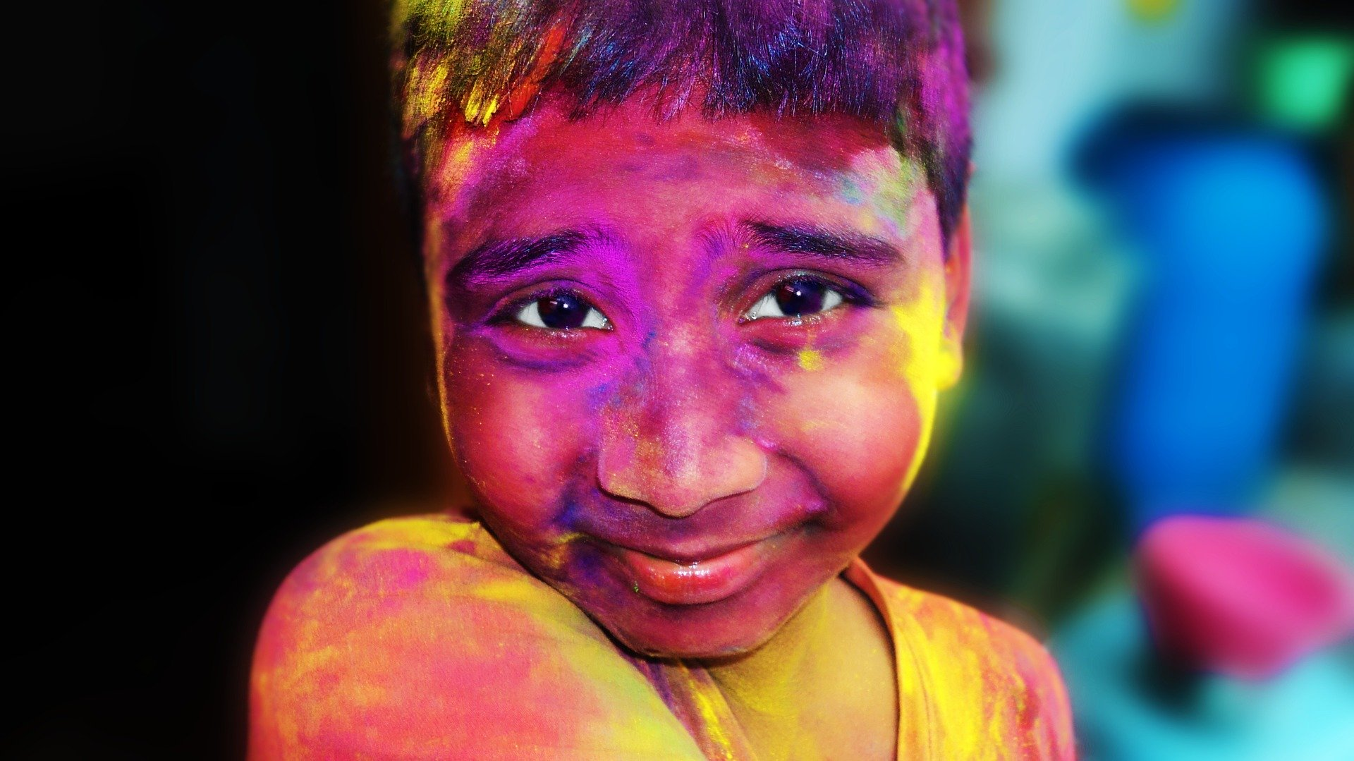 Child-with-lot-of-different-holi-colours-on-face
