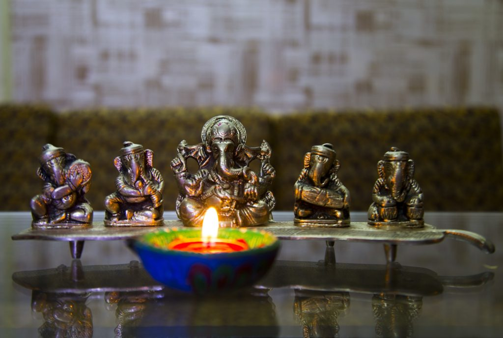 illuminated-lamp-beside-lord-ganesha-diwali-pooja